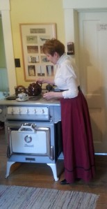 A volunteer make tea in the kitchen of the Marr Residence.