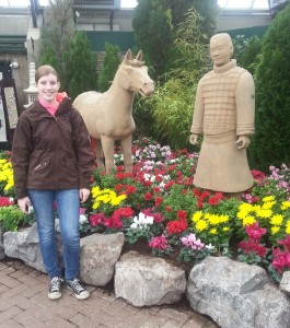 My daughter Mary posing with some statues that were part of the Chinese New Year's display.