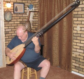 Weldon Gray playing the theorbo he built.