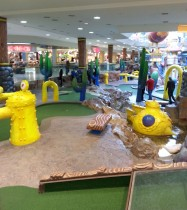 People playing miniature golf at West Edmonton Mall
